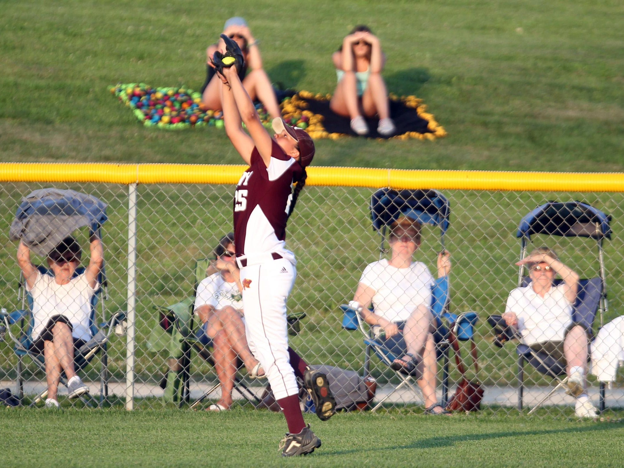 Ankeny's Kennedy Thomas reaches out to catch a deep hit during the Hawkettes' Class 5A regional championship game at West High on Tuesday, July 14, 2015. Ankeny won, 3-1, to head to state. David Scrivner / Iowa City Press-Citizen
