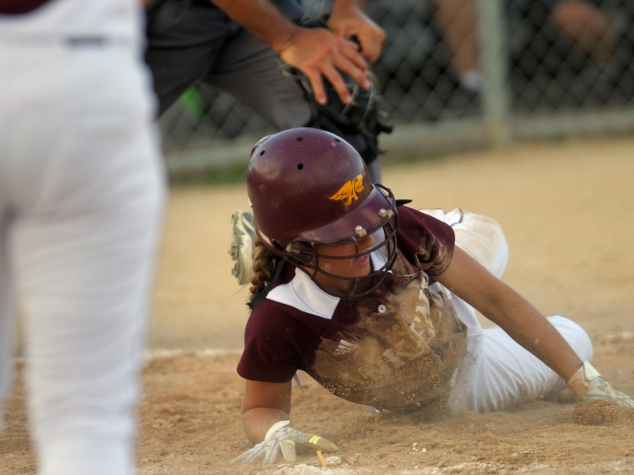 Ankeny's Gabi Bingham safely slides home during the Hawkettes' Class 5A regional championship game at West High on Tuesday, July 14, 2015. Ankeny won, 3-1, to head to state. David Scrivner / Iowa City Press-Citizen
