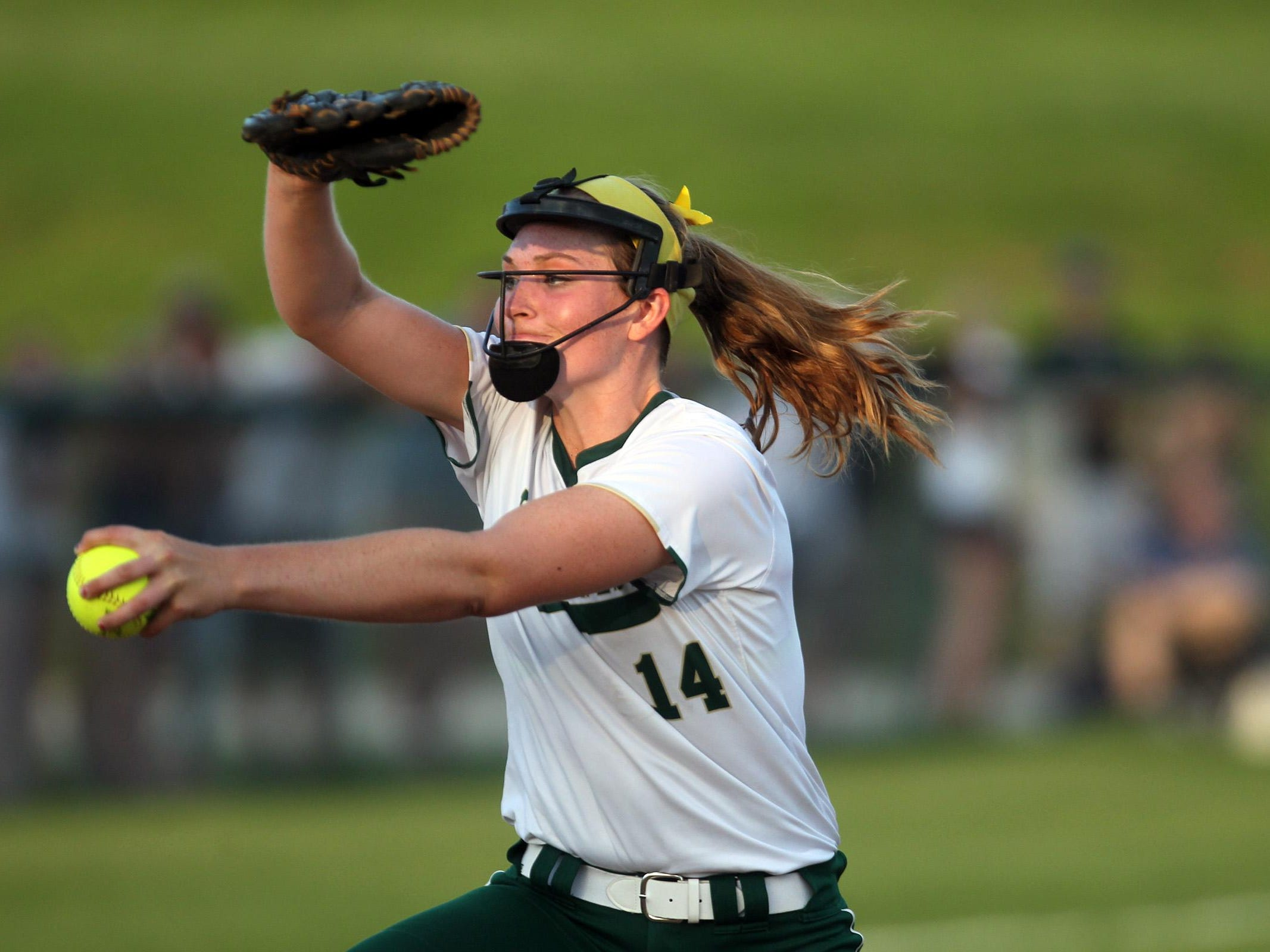 West High's Laynie Whitehead delivers a pitch during the Women of Troy's Class 5A regional championship game against Ankeny at West High on Tuesday, July 14, 2015. Ankeny won, 3-1, to head to state. David Scrivner / Iowa City Press-Citizen