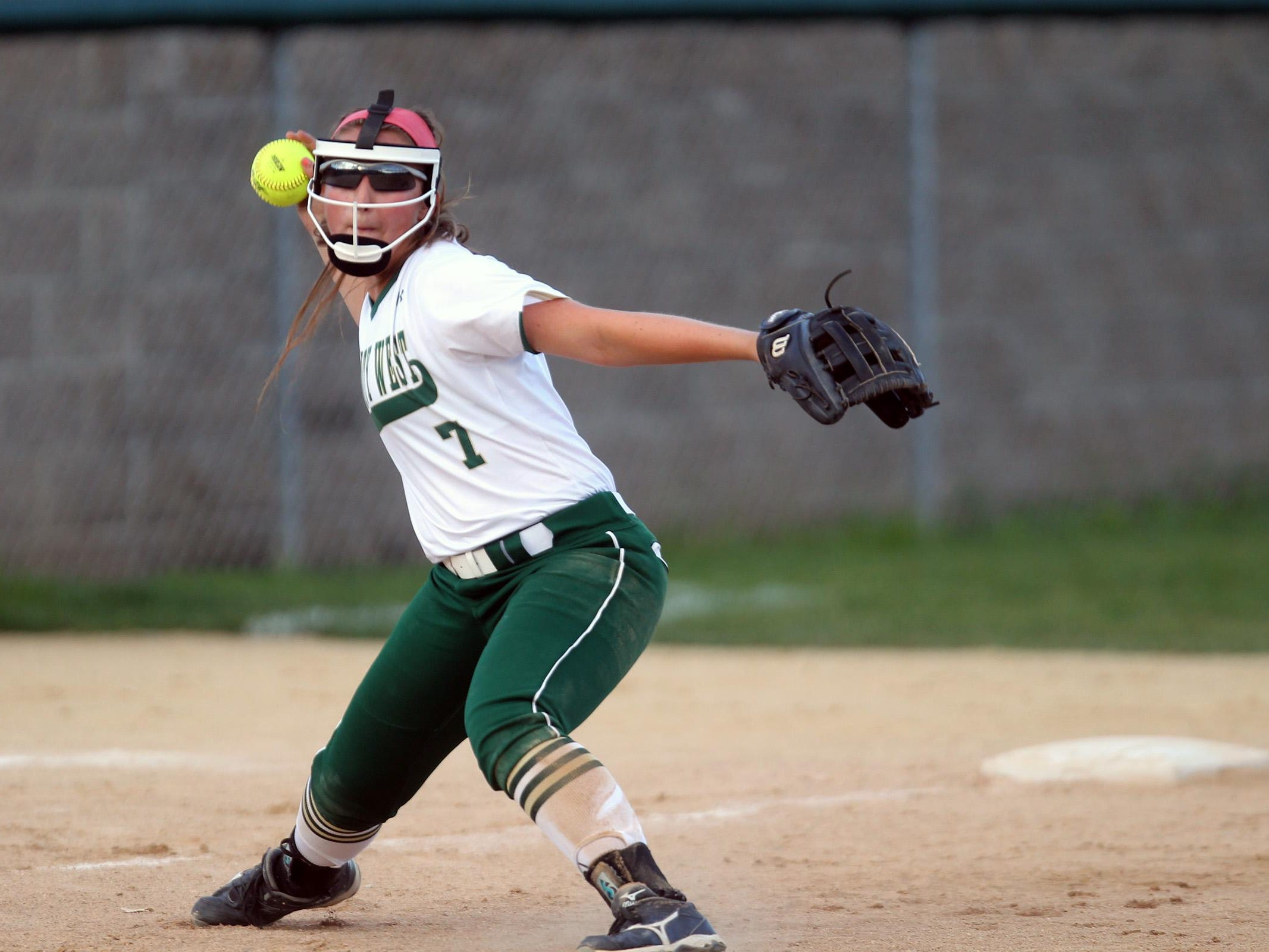 West High's Adara Opiola throws to first base during the Women of Troy's Class 5A regional championship game against Ankeny at West High on Tuesday, July 14, 2015. Ankeny won, 3-1, to head to state. David Scrivner / Iowa City Press-Citizen