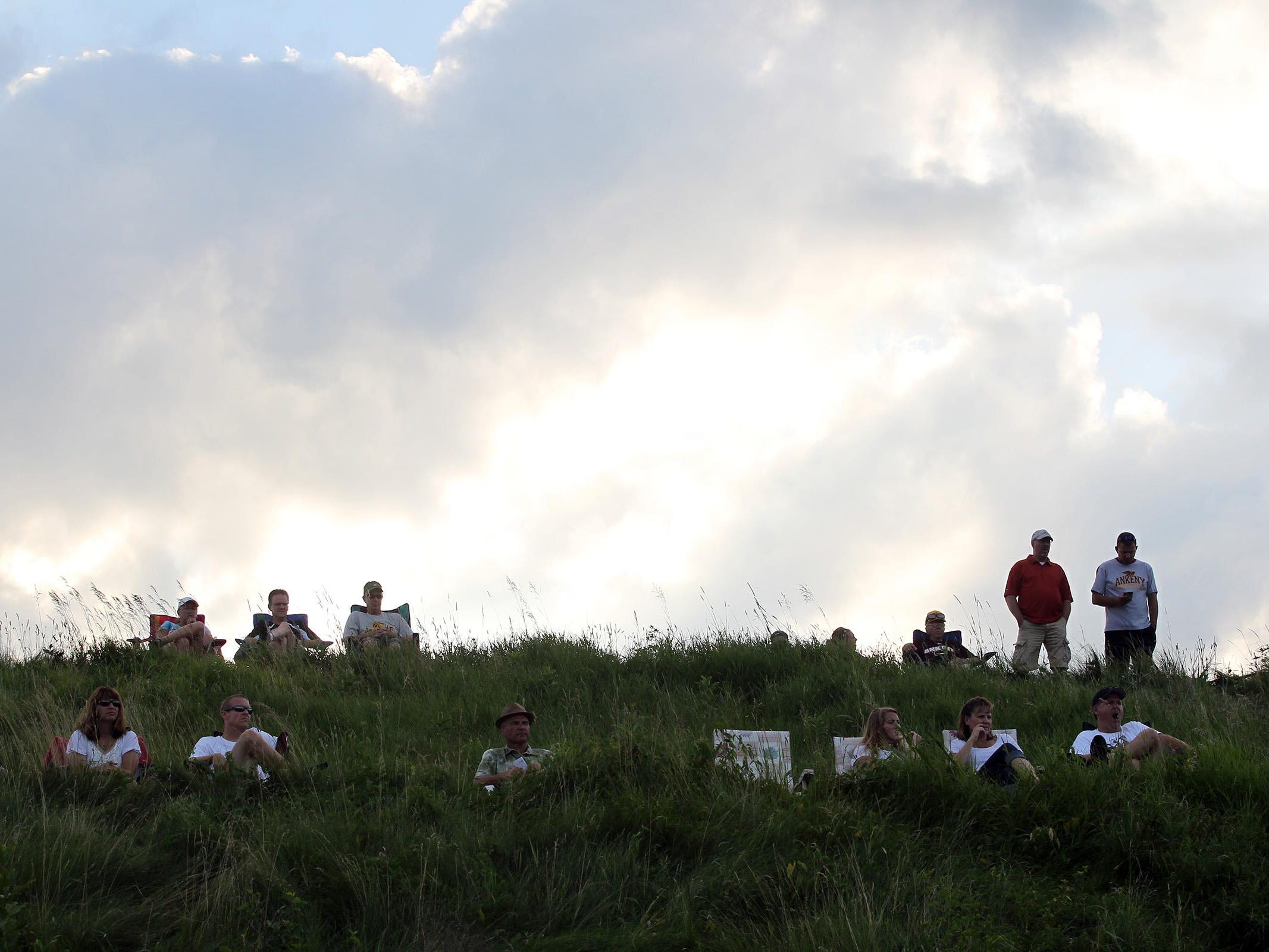 Spectators watch the Class 5A regional championship game between West High and Ankeny at West High on Tuesday, July 14, 2015. Ankeny won, 3-1, to head to state. David Scrivner / Iowa City Press-Citizen