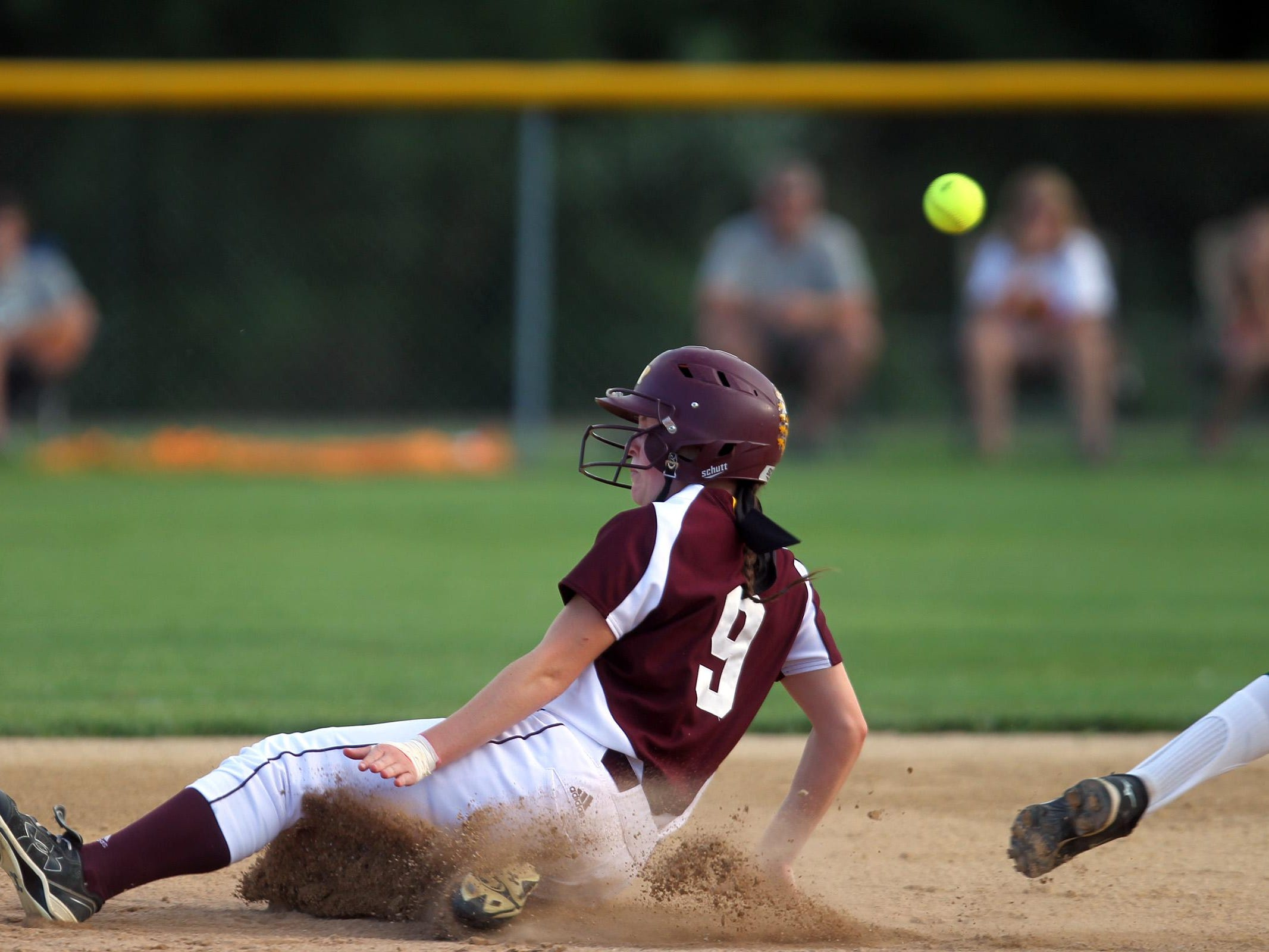 Ankeny's Olivia Brooks safely slides to second base during the Hawkettes' Class 5A regional championship game at West High on Tuesday, July 14, 2015. Ankeny won, 3-1, to head to state. David Scrivner / Iowa City Press-Citizen