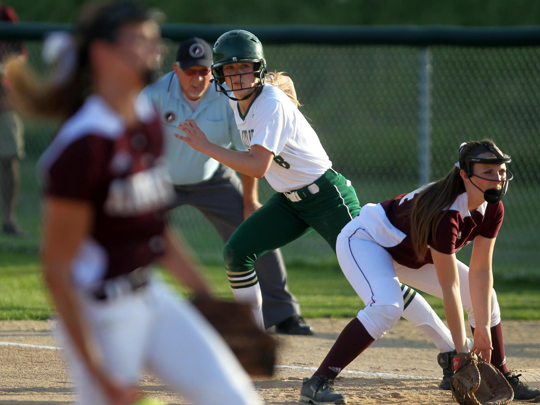 West High's Christine Kallsen leads off first base during the Women of Troy's Class 5A regional championship game against Ankeny at West High on Tuesday, July 14, 2015. Ankeny won, 3-1, to head to state. David Scrivner / Iowa City Press-Citizen