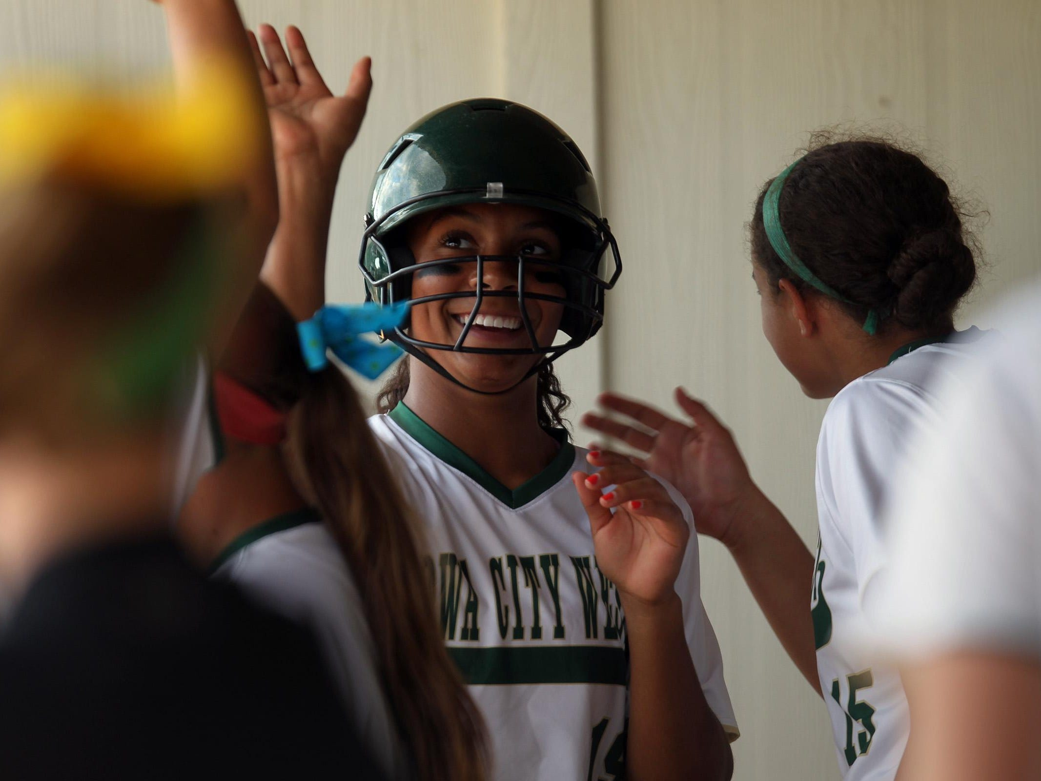 West High's Taleah Smith gets high-fives after running in a score for the Women of Troy during their Class 5A regional championship game against Ankeny at West High on Tuesday, July 14, 2015. Ankeny won, 3-1, to head to state. David Scrivner / Iowa City Press-Citizen