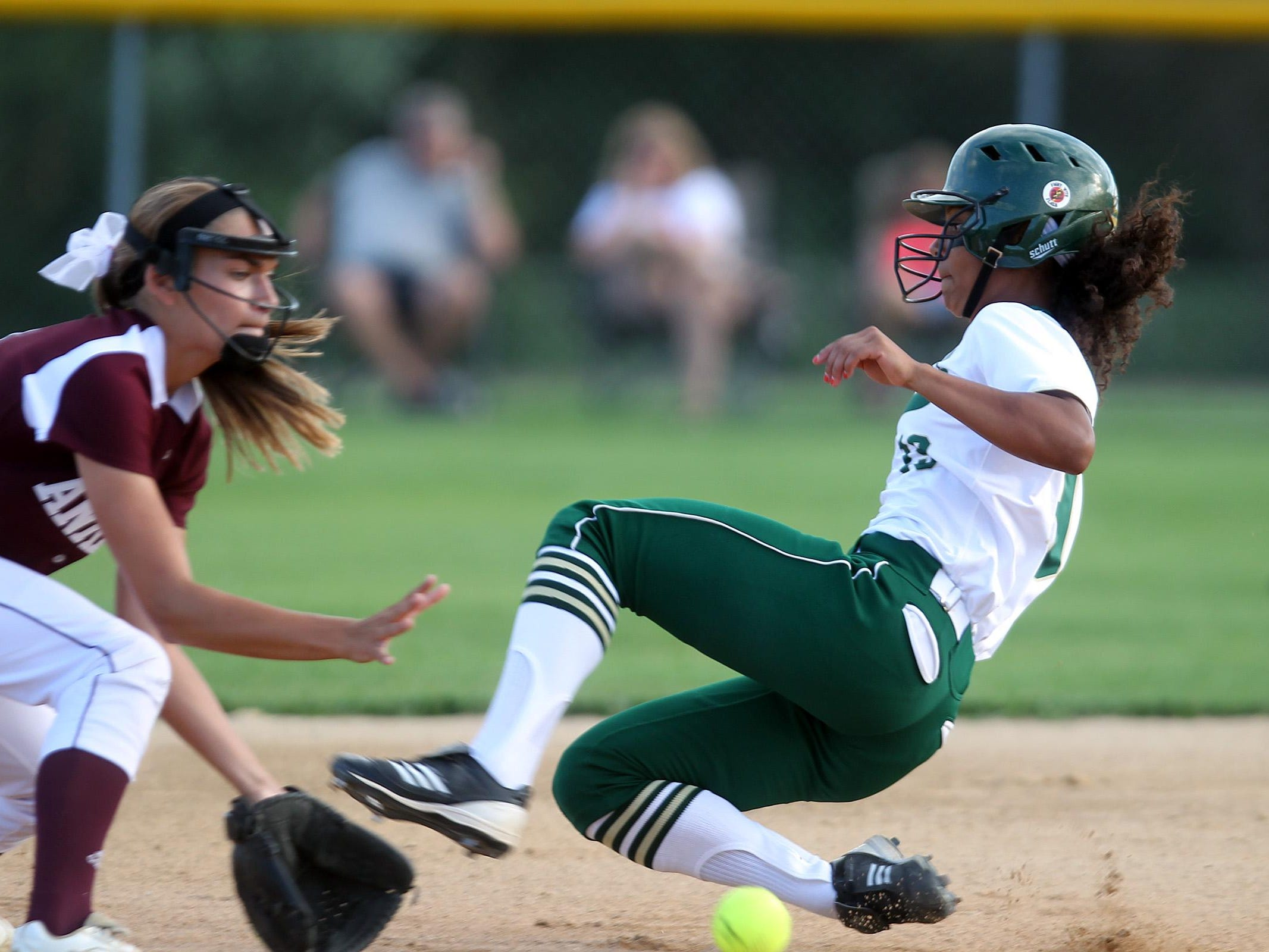 West High's Taleah Smith safely slides past Ankeny's Peyton Daugherty during their Class 5A regional championship game at West High on Tuesday, July 14, 2015. Ankeny won, 3-1, to head to state. David Scrivner / Iowa City Press-Citizen