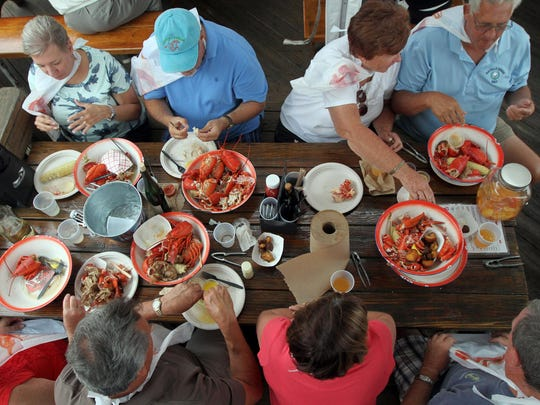 Diners dig into lobster dinners at Boondocks Fishery in Red Bank.