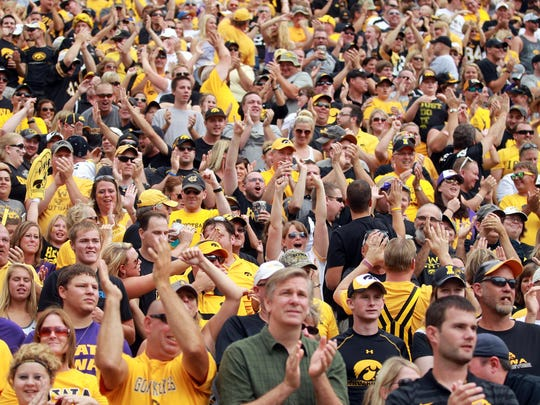 Iowa fans cheer during the Hawkeyes' game against the University of Iowa at Kinnick Stadium in 2014.