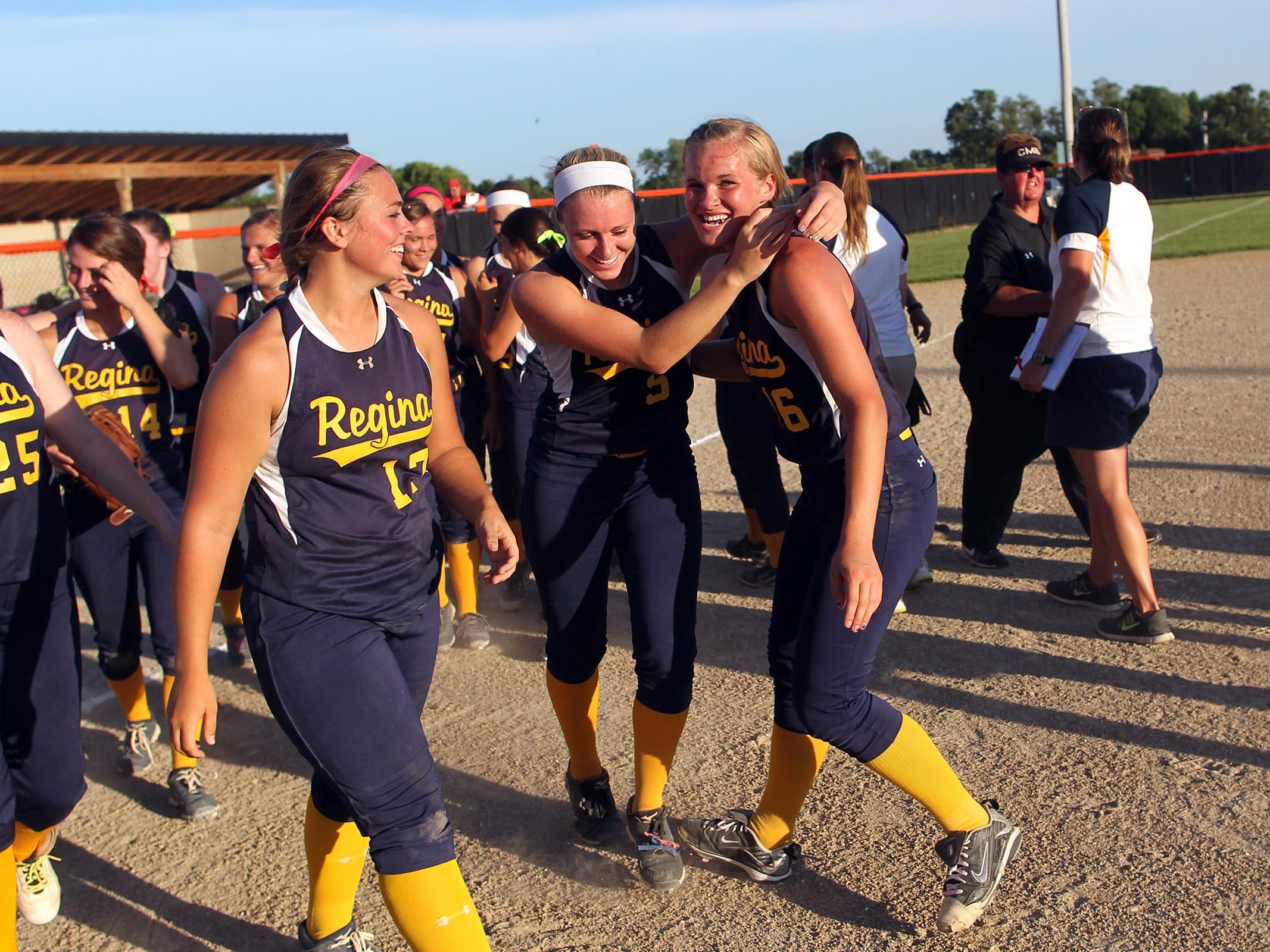 Regina pitcher Sarah Lehman, right, gets a hug from Kennedy Brown following the Regals' Class 2A regional championship against Collins-Maxwell/Baxter in Grinnell on Monday, July 13, 2015.