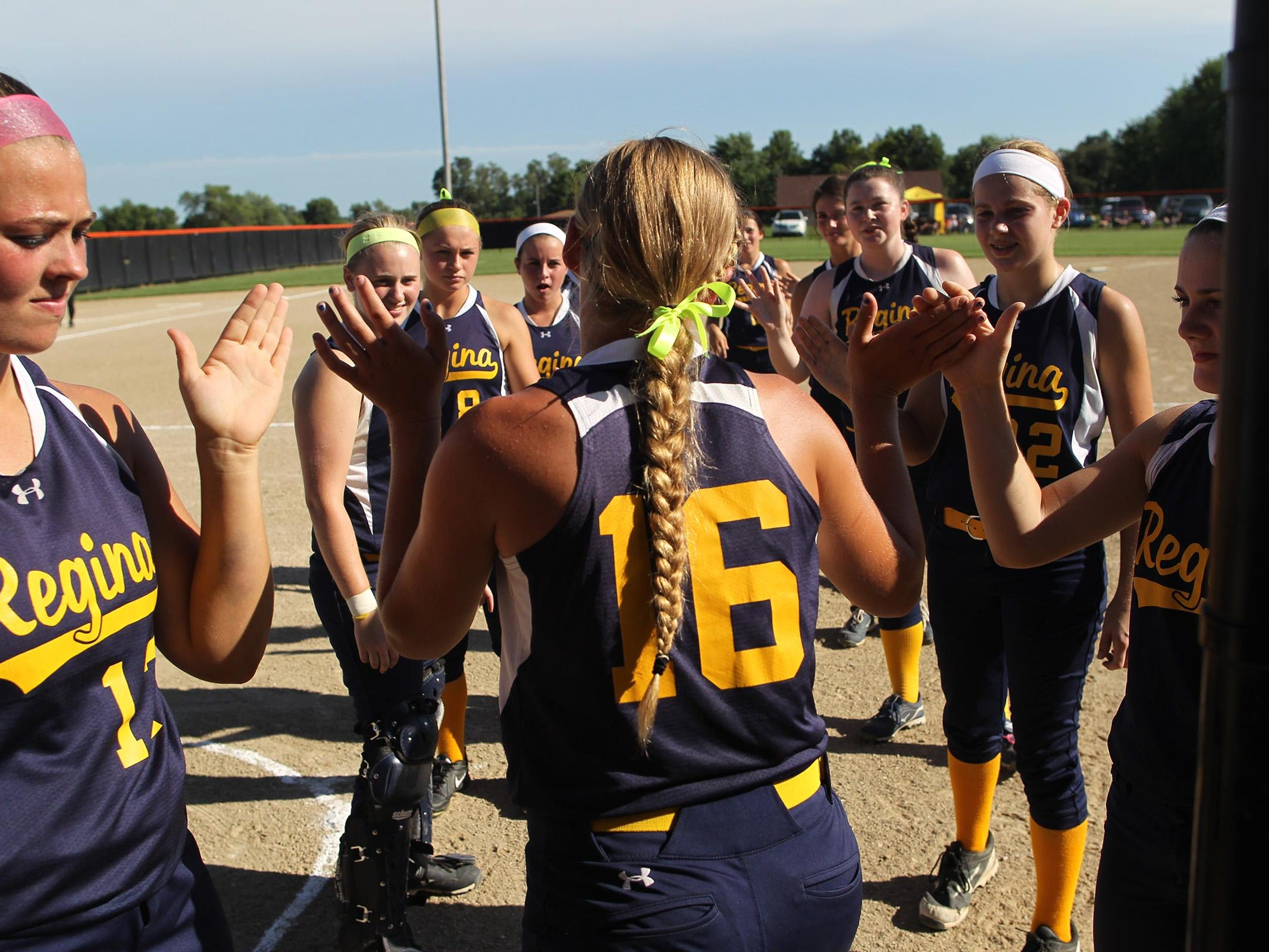 Regina's Sarah Lehman is introduced prior to the Regals' Class 2A regional championship in Grinnell on Monday, July 13, 2015.