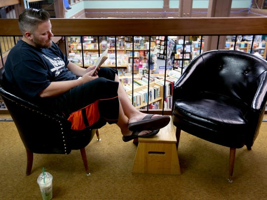 Joe Hansen, 33, of Silverton, catches up on some reading at the Book Bin in downtown Salem on Thursday, July 2, 2015.