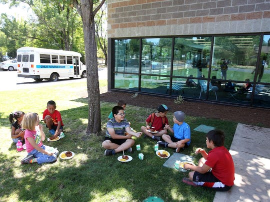 Children eat lunch at the Boys and Girls Club on Tuesday, July 14, 2015, in Salem.