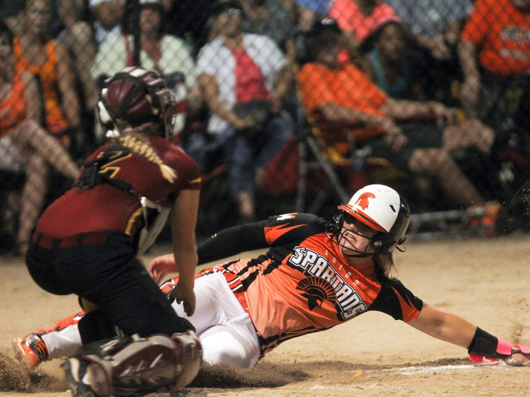 Solon's Ali Herdliska gets tagged out at home plate during the Spartans' Class 3A regional championship against PCM, Monroe in Grinnell on Monday, July 13, 2015. David Scrivner / Iowa City Press-Citizen
