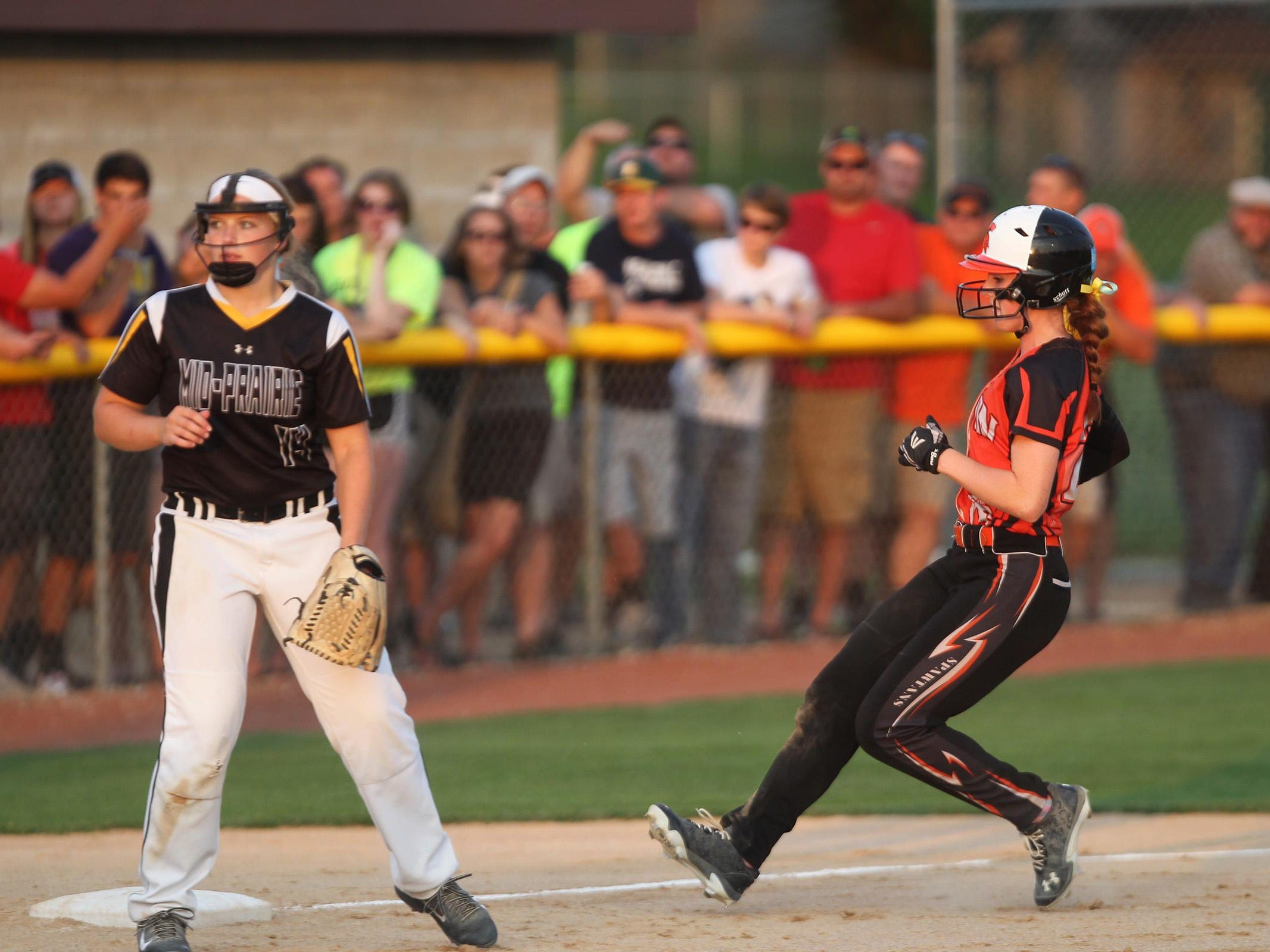 Solon's Jess Heick makes her wait to third base during the Spartans' regional game against Mid-Prairie at Solon on Friday, July 10, 2015. David Scrivner / Iowa City Press-Citizen
