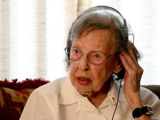 Mary Venturacci, 98, listens with headphones as a Kaiser Permanente nurse practitioner conducts an in-home medical visit in Salem on Friday, July 10, 2015.