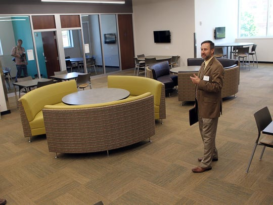Von Stange, senior director of university housing and dining, guides media through a tour of a study lounge in the Mary Louise Petersen Residence Hall on Tuesday, July 21, 2015.