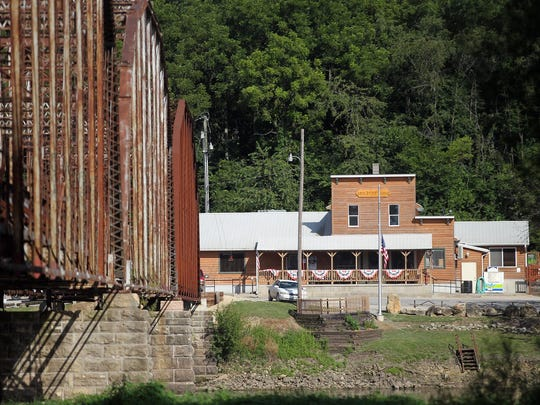 The Sutliff Tavern is seen across from the Sutliff Bridge on Tuesday, July 21, 2015.
