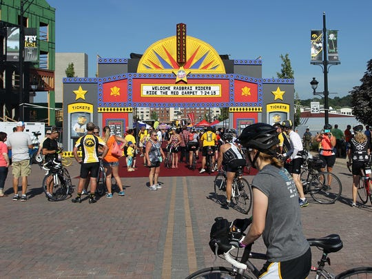 RAGBRAI riders arrive at the Iowa River Landing in Coralville on Friday.