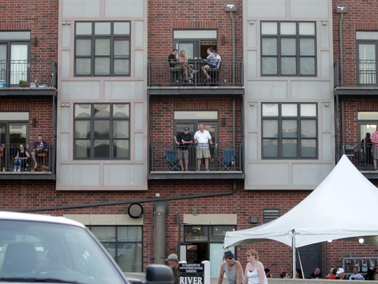 Spectators enjoy Cheap Trick's RAGBRAI performance from their balcony in Coralville on Friday, July 24, 2015.