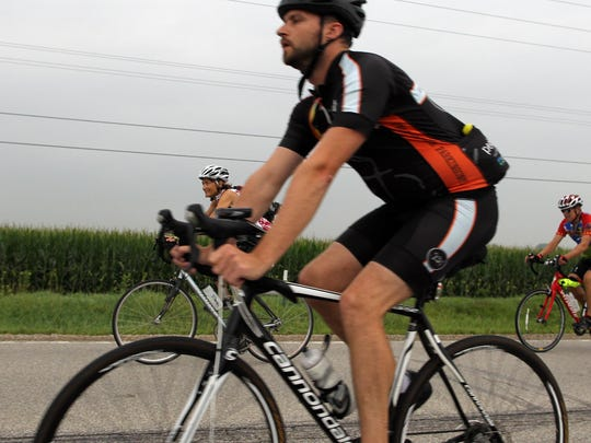 RAGBRAI cyclists ride down Highway 6 outside of West Liberty on Saturday, July 25, 2015.
