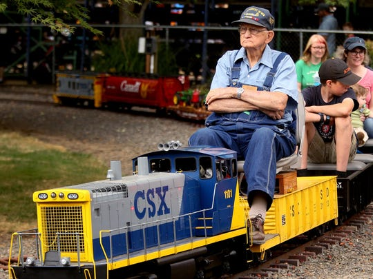 Jack Chapman, 93, of Salem, leads a miniature railroad ride at the 45th annual Great Oregon Steam-Up at the Antique Powerland in Brooks, Ore., on Sunday, July 26, 2015.