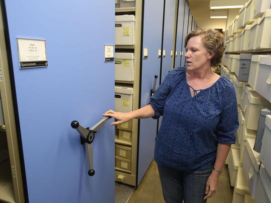 Mary McRobinson, Willamette University archivist, gives a tour of the school's archives. These rolling shelves save space in the climate-controlled storage at the Mark O. Hatfield Library.