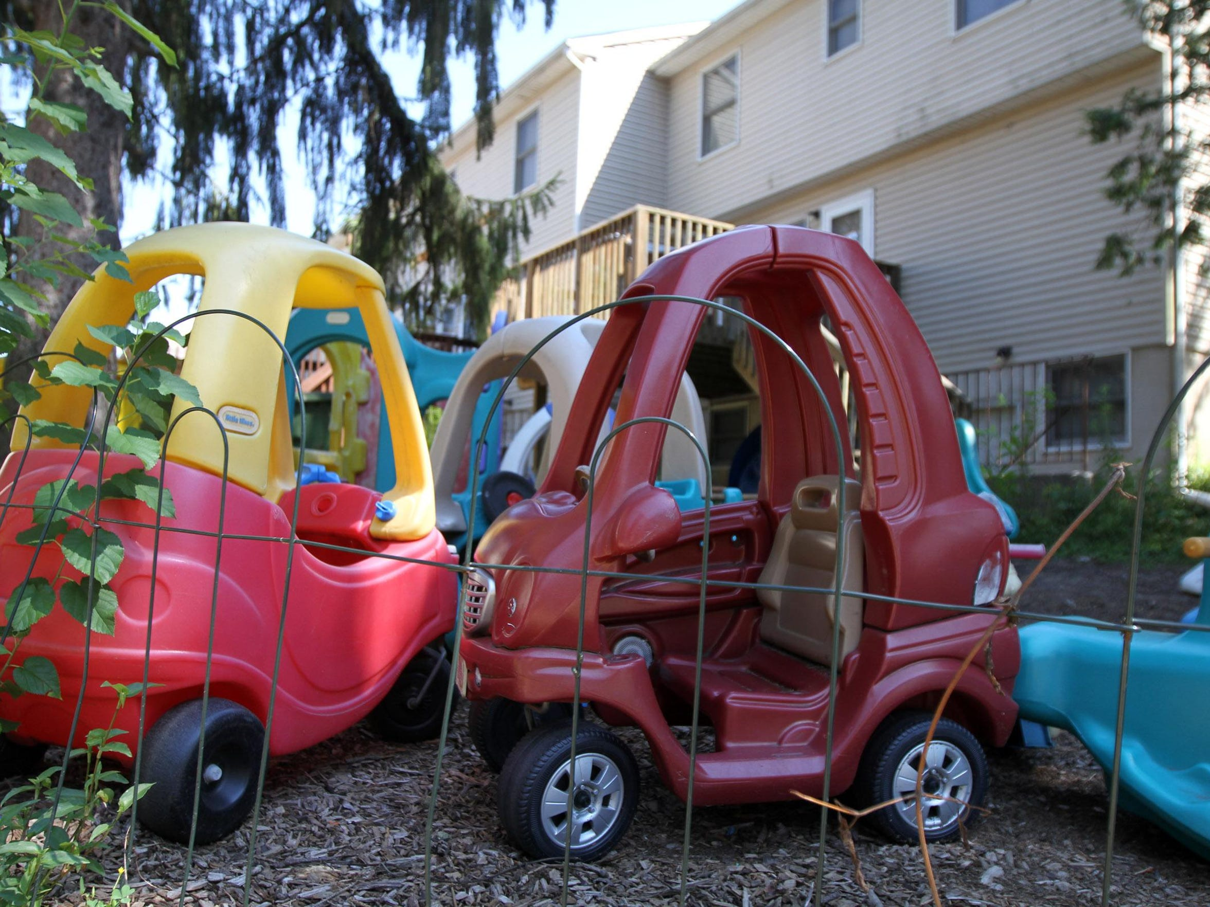 A traffic jam of plastic kid cars along North Lake