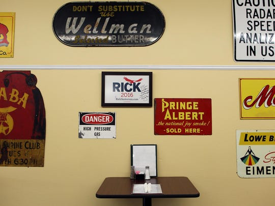 Wall decorations, including a note from Republican presidential candidate Rick Santorum, hang on the walls of Mr. O's Cafe in Wellman.