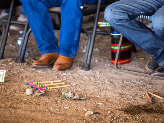 """Bets lay on the ground next to counting sticks during the Pat """"Bum"""" Boss Ribs Sr. Memorial stick game tournament in Heart Butte on Saturday."""