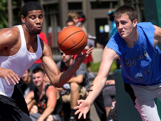 The NW Wolves and the 22nd Street Ballers compete during the Oregon National Guard Hoopla XVII at the Oregon State Capitol in Salem on Sunday, Aug. 9, 2015.