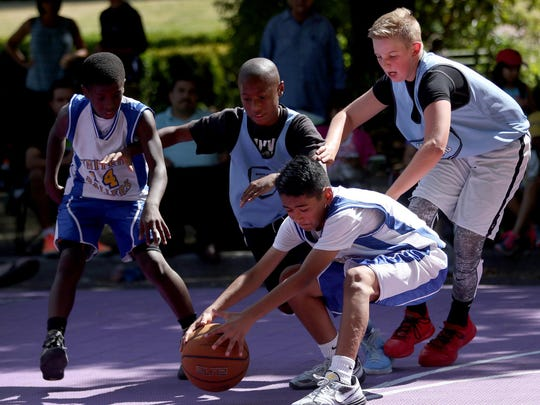 The Hard Ballers and Gettin' Buckets compete during the Oregon National Guard Hoopla XVII at the Oregon State Capitol in Salem on Sunday, Aug. 9, 2015.