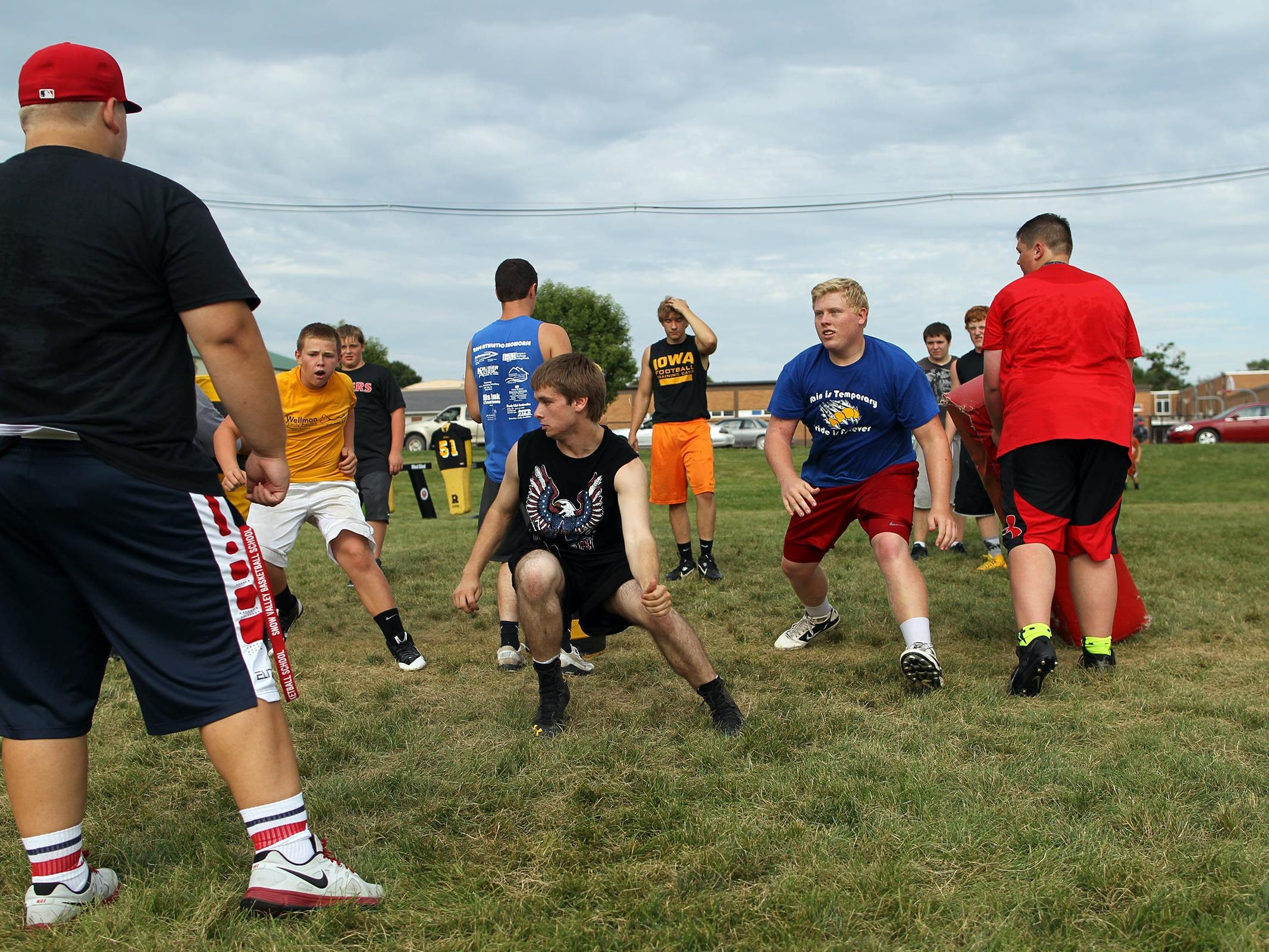 Lone Tree defenders run drills on Aug. 6. Senior Greg Feldman, an all-district linebacker, leads the defense after finishing third on the team with 48 tackles in 2014.