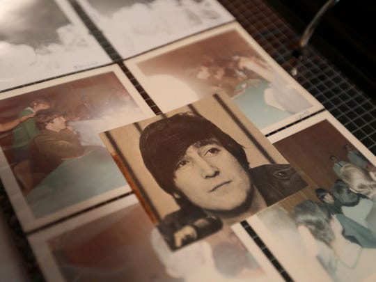 Dian Lawrence looks through a photo album that includes some of the pictures she took of The Beatles when she attended a press conference and concert 50 years ago in Portland.