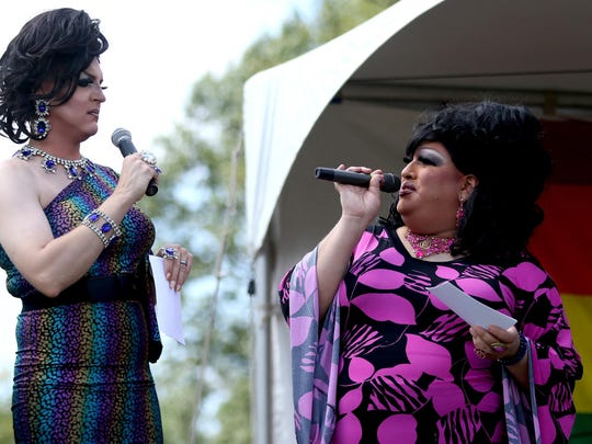 Hosts FabuLanzaa L'Eville, left, and RiRi Caliente speak at Capitol Pride at Riverfront Park in Salem on Saturday, Aug. 15, 2015.