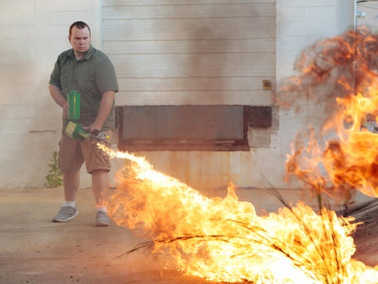 """Chris Byars, CEO and project leader at the Ion Productions Team, demonstrates a flamethrower available to the public. He says, """"Simply owning a particular product should not be a punishable offense. It's a matter of education and respect for safety."""""""