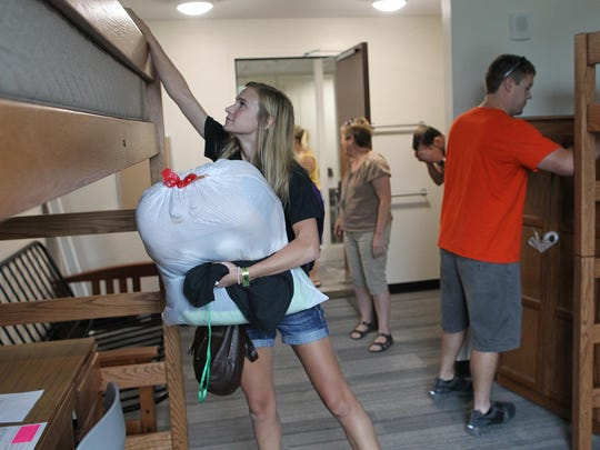 University of Iowa freshman Rebecca Schwartzenburg of Marshalltown unpacks inside her new room at the Mary Louise Petersen Residence Hall on Tuesday.