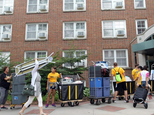 University of Iowa students, parents and volunteers wait in line for the elevator at Hillcrest Hall as they move in before the start of the semester in fall 2015.