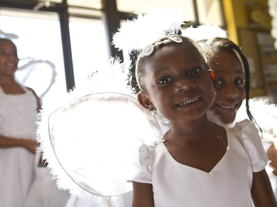 The flower girls wore angel wings.