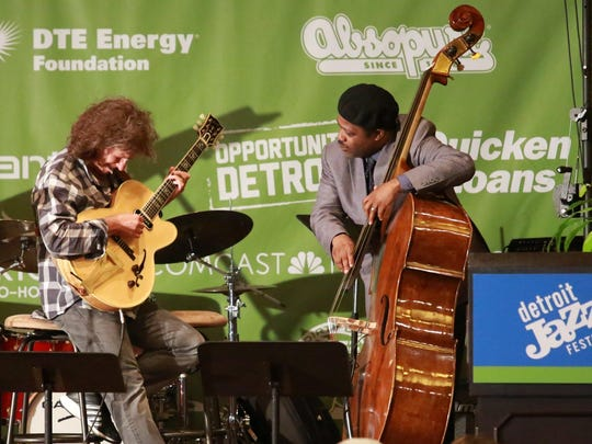 Guitarist Pat Metheny performs with bassist Rodney Whitaker during the kickoff reception in April for the Detroit Jazz Festival.