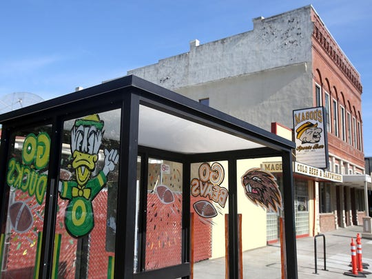 The bus shelter in front of Magoo's Sports Bar in downtown Salem was painted by employees of the bar.
