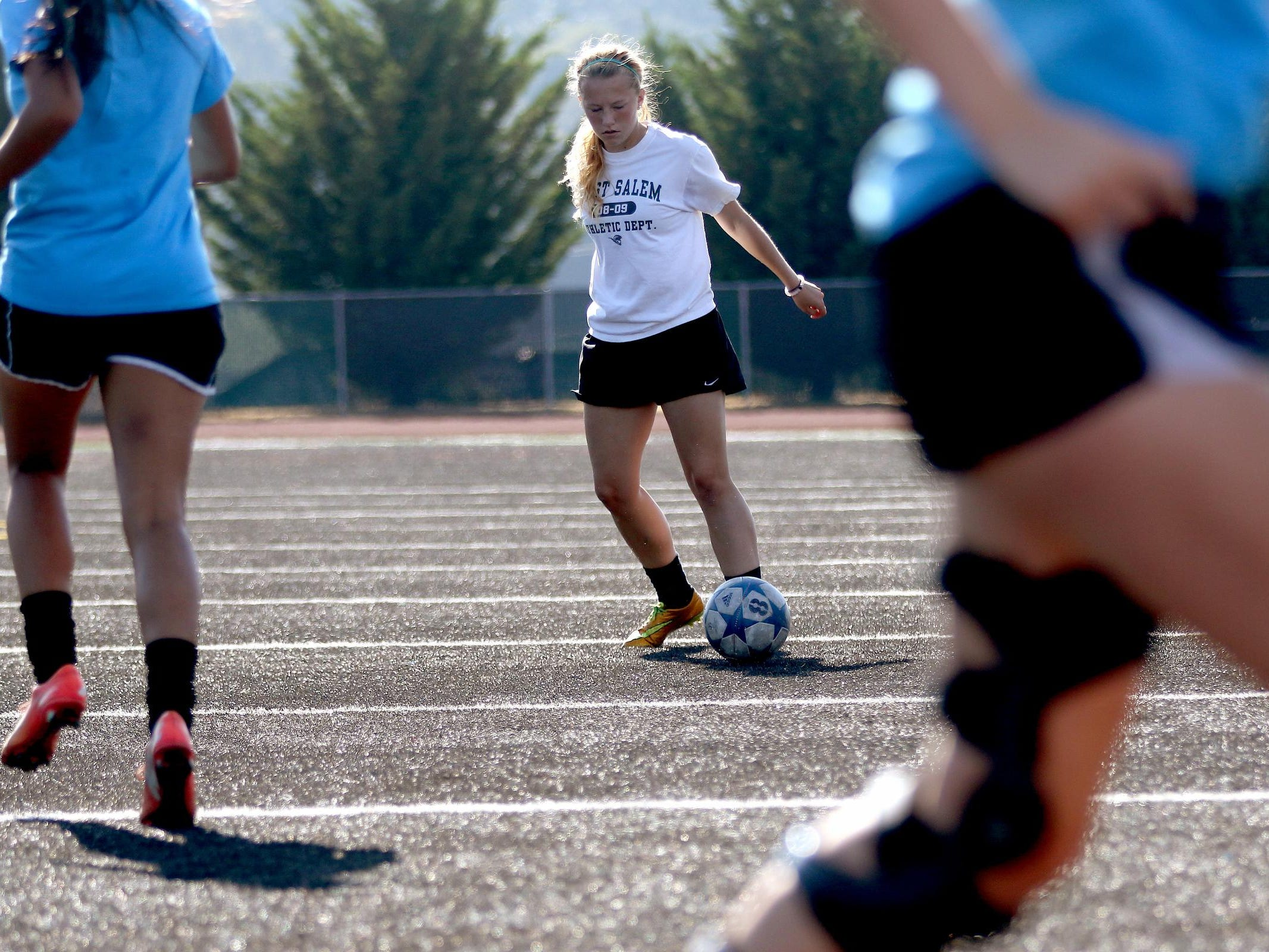 Senior Anna Norrenberns moves with the ball during girl's soccer practice at West Salem High School on Thursday, Aug. 27, 2015.