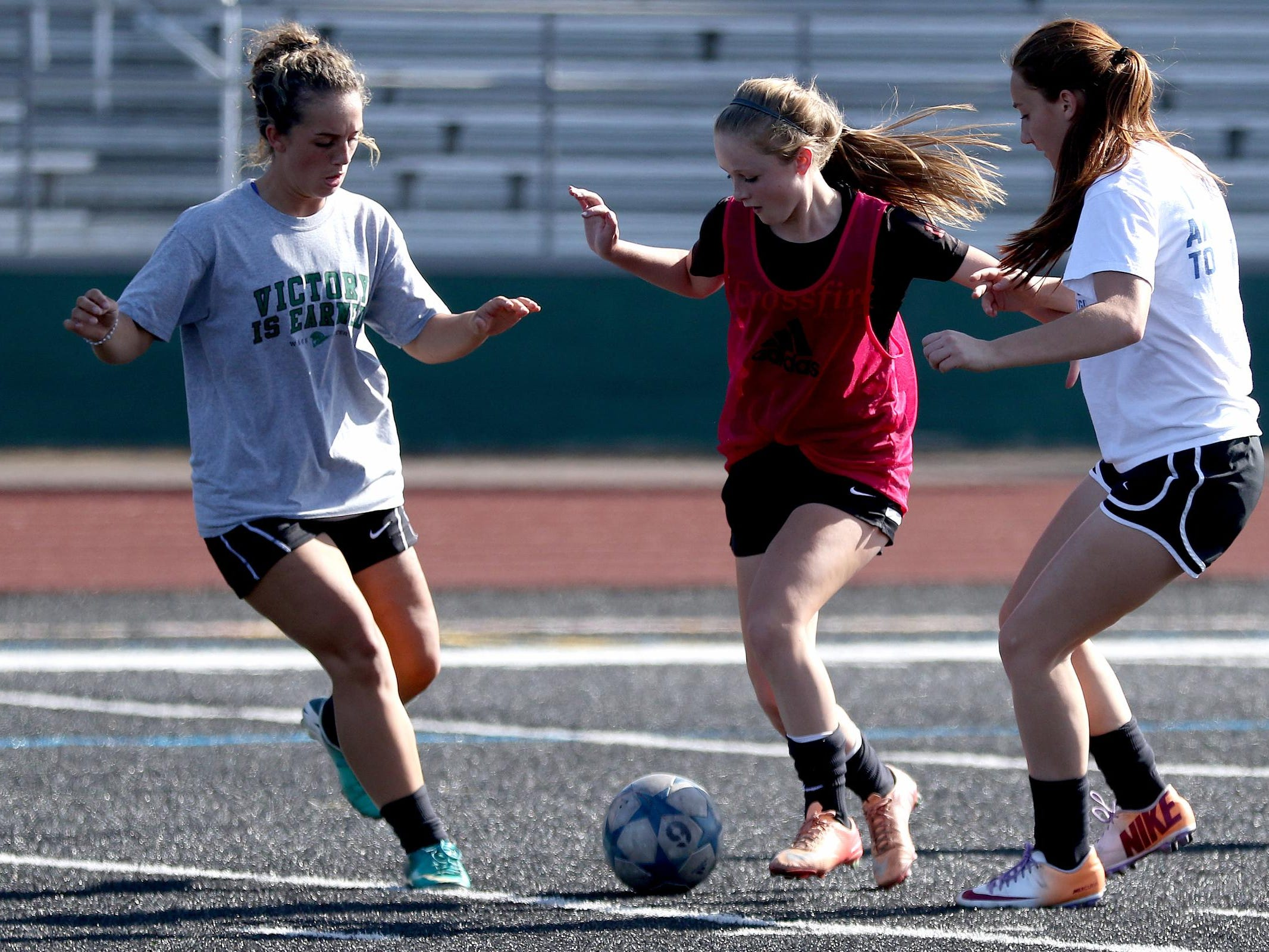 Players scrimmage during girl's soccer practice at West Salem High School on Thursday, Aug. 27, 2015.