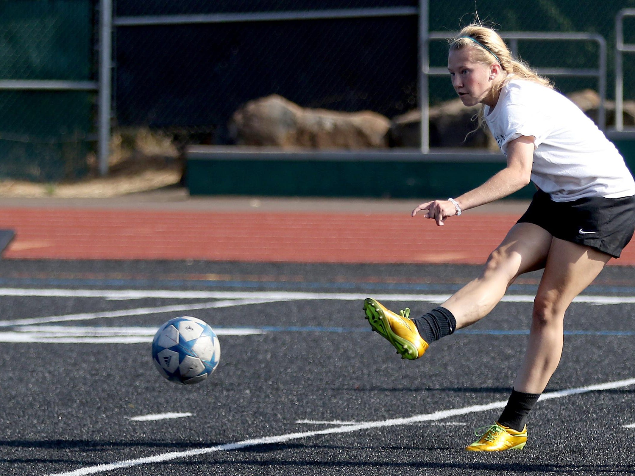 Senior Anna Norrenberns kicks the ball during girl's soccer practice at West Salem High School on Thursday, Aug. 27, 2015.