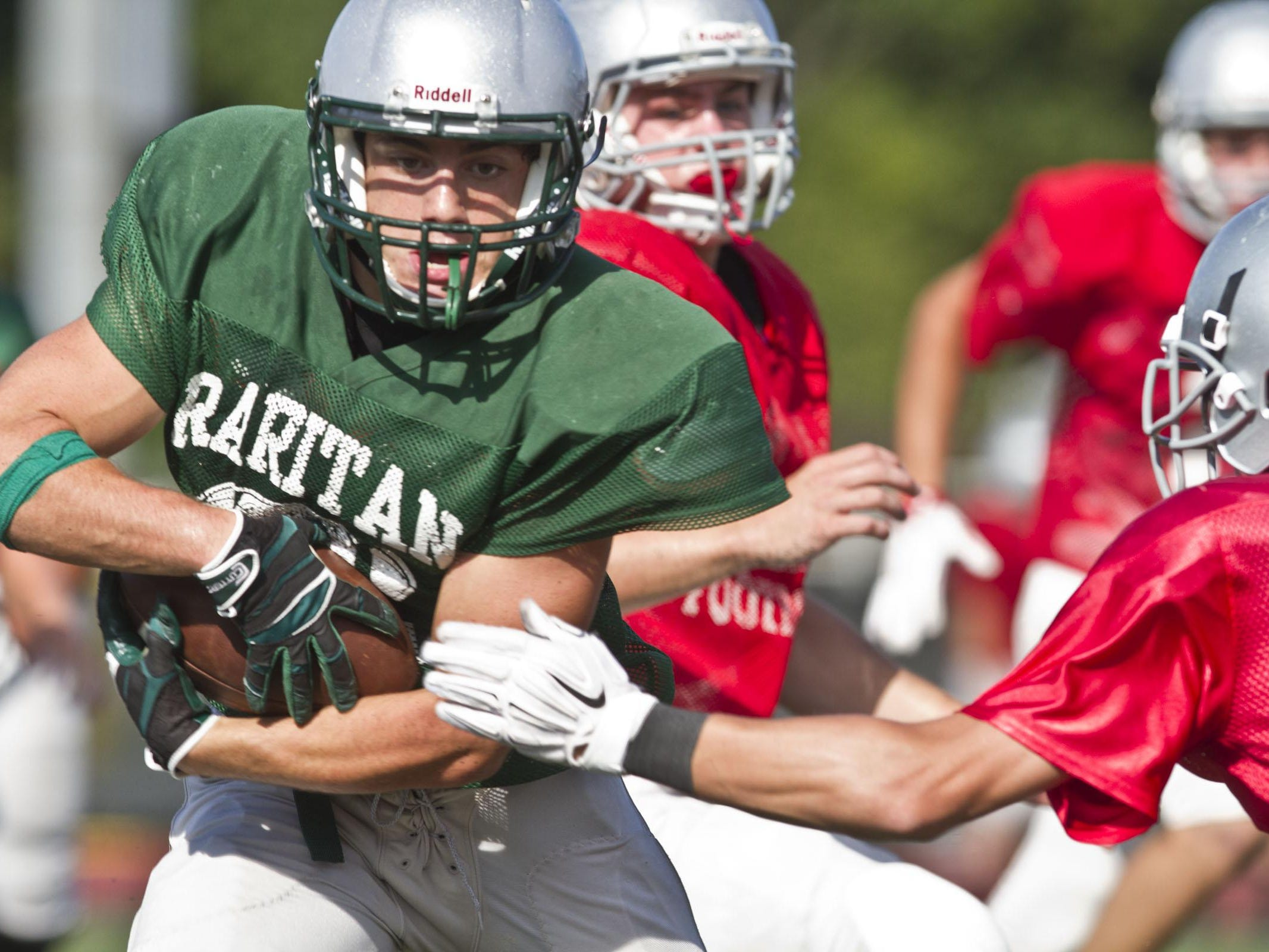 Raritan's Derek Ernst runs with the ball during a scrimmage against Wall on Aug. 27.