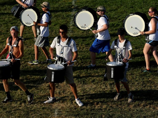 The drumline performs during marching band camp before the school year begins at West Salem High School in Salem on Wednesday, Aug. 19, 2015.