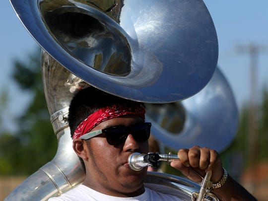 A sousaphone player marches during marching band camp before the school year begins at West Salem High School in Salem on Wednesday, Aug. 19, 2015.
