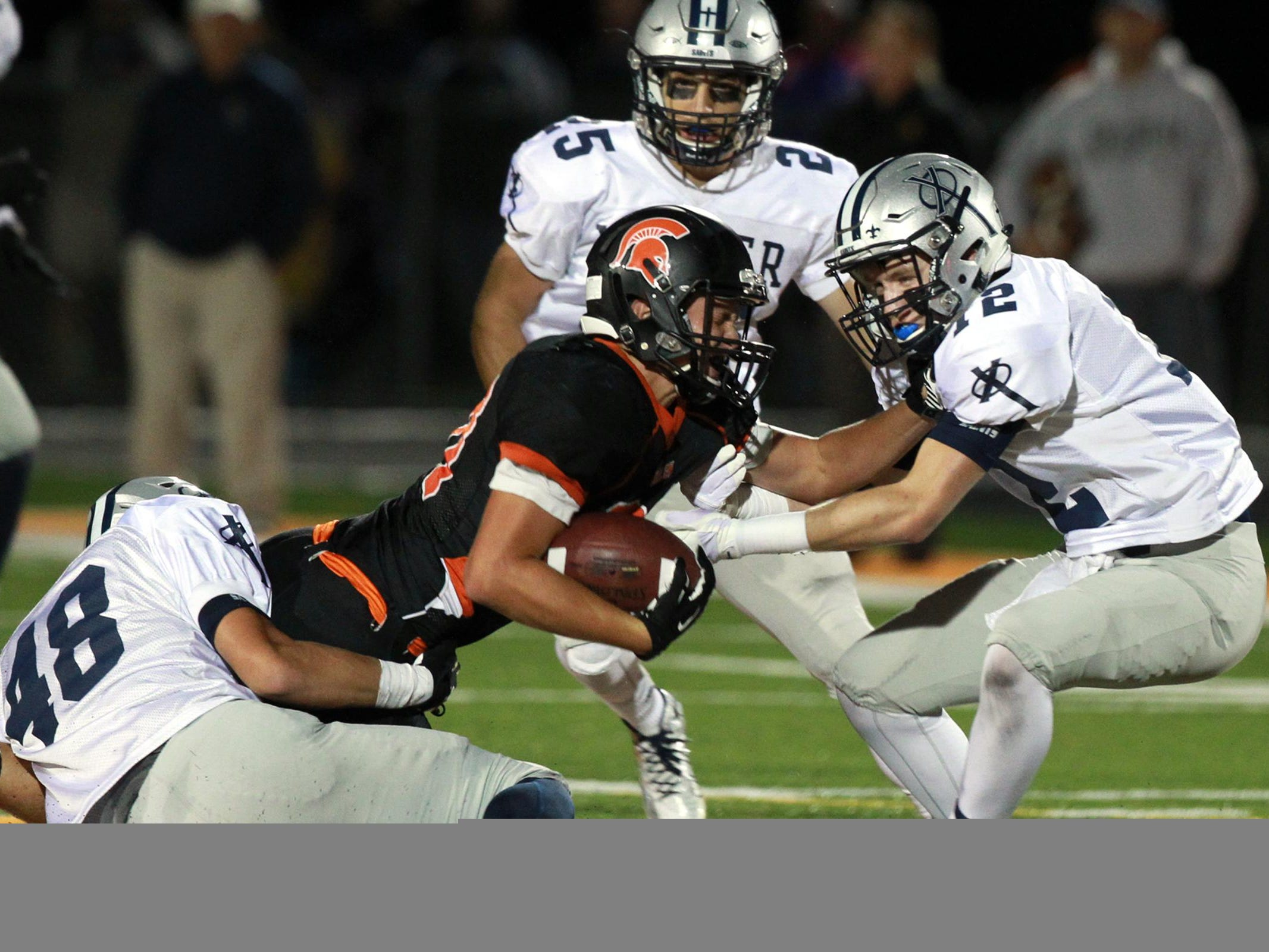 Solon's Bo Black converts a third down during the Spartans' game against Cedar Rapids Xavier at Solon on Friday.