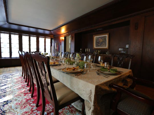 The dining room has floor-to-ceiling wood paneling, intricate carvings and hidden storage doors. It's protected by the state.