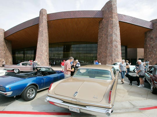 Visitors check out classic cars at Modernism Week's vintage car show in February 2012.