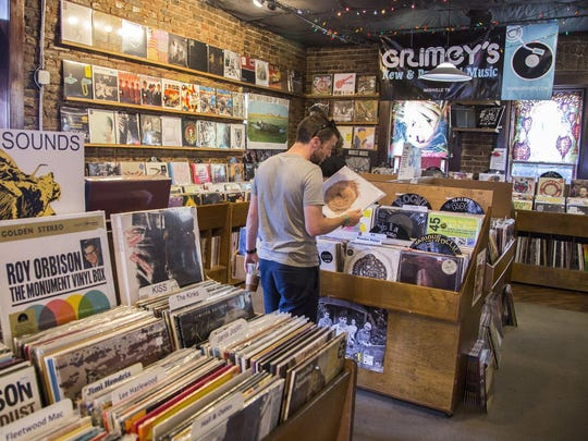 Customers browse records at Grimey's in Nashville, Tenn. The city is the home of country music, where the Grand Ole Opry got its start 90 years ago. In Nashville, music is everywhere and it's intimate and diverse.