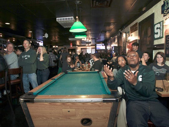 Spartan alum David James of Detroit, foreground, came to the Peanut Barrel last April to watch MSU play Duke in the Final Four semifinals.